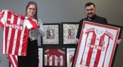 Listers Central donates Stoke City memorabilia to Staffordshire Hospice