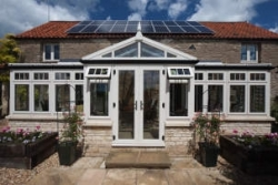 Agricultural barn converted into energy efficient home with Spectus PVC-U